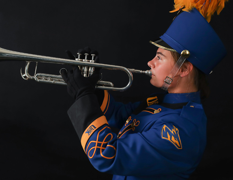 UNK junior Sadie Uhing was the first person to perform in the new marching band uniforms.