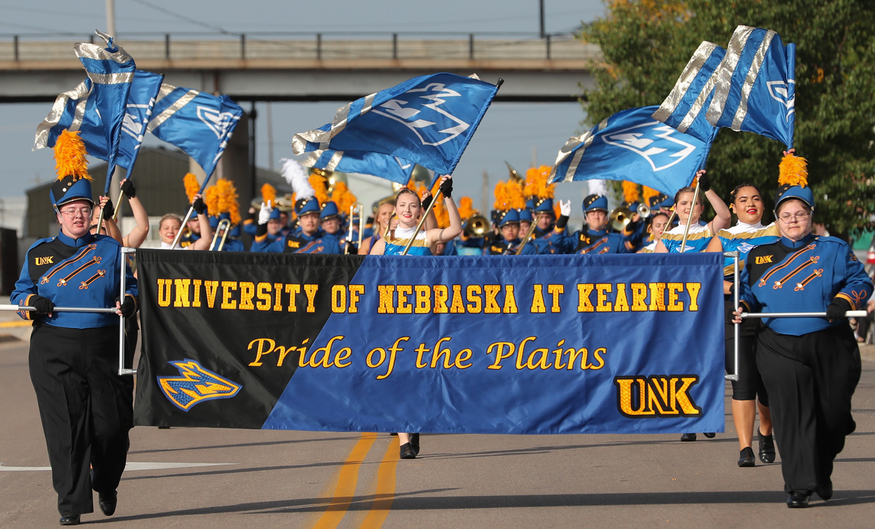 The Pride of the Plains Marching Band debuted its new uniforms and banner Saturday during the UNK Band Day Parade in downtown Kearney.