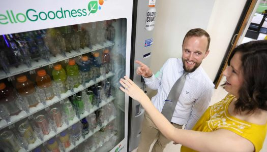 UNK graduate student Ali Malmkar, right, visits with assistant professor Bryce Abbey about healthy vending machine options on campus. (Photo by Corbey R. Dorsey/UNK Communications)