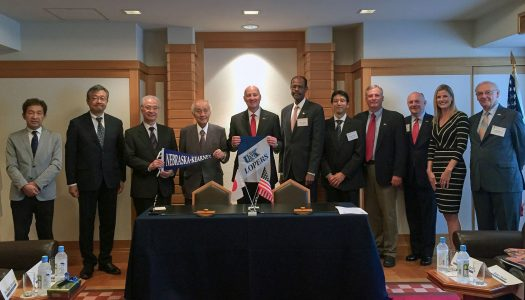 Nebraska Gov. Pete Ricketts, middle, and UNK's Gilbert Hinga, sixth from left, and Satoshi Machida, seventh from left, meet with Nebraska, U.S. and Japanese dignitaries Monday at the Midwest-U.S. Japan Association conference in Japan. UNK signed a student and faculty exchange agreement at the conference with Toyo University.