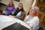 """Senior Lecturer Nadine Stuehm, far right, visits with her class at Cambridge Court senior living facility. """"I want our students to come out of this with an understanding of older people and how to better relate to them,"""" she said. (Photo by Corbey R. Dorsey, UNK Communications)"""