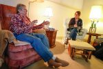 UNK social work student Julia Daro discusses end-of-life plans with Cambridge Court resident Judith Middleton. Daro and other UNK students meet one-on-one and conduct psychosocial assessments of elderly residents. (Photo by Corbey R. Dorsey, UNK Communicatio