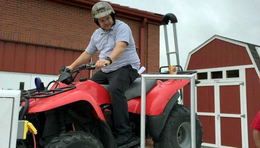 Aaron Yoder of the Central States Center for Agricultural Safety and Health at UNMC demonstrates ATV safety tips on the ATV simulator that will be used in the statewide training courses.