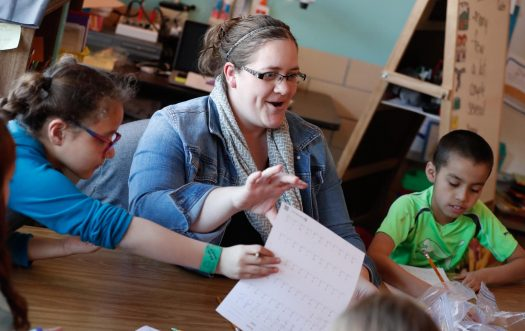 Bryant Elementary School first-grade teacher Michelle Fouts uses a variety of hands-on activities to keep students active and engaged. The UNK alumna was inducted Thursday into UNK's Academy for Teacher Education Excellence. (Photo by Corbey R. Dorsey, UNK Communications)