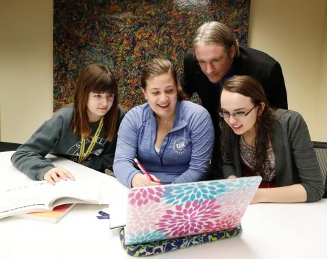 University of Nebraska at Kearney student Bayleigh Nemeth, center, and Associate Director of Learning Commons Patrick Hargon work with students Sarah Laden, far left, and Jaime Hoefer as part of UNK's success coaching program, which provides one-one-one academic support. (Photo by Corbey R. Dorsey, UNK Communications)