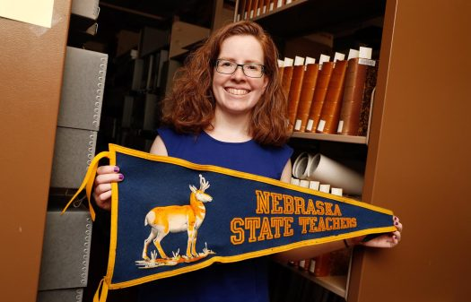 """UNK archivist Laurinda Weisse describes her position as """"a librarian for the rare and unique, special, one-of-a-kind items on campus."""" The archives are home to everything from old school pennants and photos to an insect collection. (Photo by Corbey R. Dorsey, UNK Communications)"""
