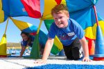 Brody Barker of Meadowlark Elementary in Kearney participates in a game at Nebraska Kids Fitness and Nutrition Day. More than 800 fourth-grade students from central Nebraska attended Friday's event, learning about fitness and healthy eating. (Photo by Corbey R. Dorsey, UNK Communications)