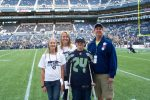 From left, Katie, Deb, Kyle and Kip Anderson pose for a photo while attending a Seattle Seahawks game in September 2012. The Make-A-Wish Foundation arranged the trip for Kyle and his family since the Seahawks are his favorite NFL team. (Photo courtesy of the Seattle Seahawks)