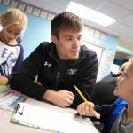 UNK head wrestling coach Dalton Jensen chats with students at Meadowlark Elementary School during a recent visit. The UNK wrestling team is partnering with the Kearney elementary school through the new Loper AthLEADS program. (Photo by Corbey R. Dorsey, UNK Communications)