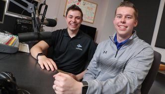 """UNK students Austin Jacobsen, left, and Evan Jones are finalists in the best football play-by-play and best sports pregame/postgame show categories of the Intercollegiate Broadcasting System College Media Awards. Jacobsen and Jones broadcast Loper football games for KLPR 91.1 FM and host the """"UNK Gameday"""" pregame show. (Photo by Corbey R. Dorsey, UNK Communications)"""