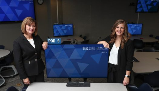 Director Gloria Vavricka, left, and assistant director of online recruitment Alyssa Wyant are part of the UNK eCampus team. eCampus works with academic departments to grow the number of UNK courses and programs offered online and boost distance-learning enrollment. (Photo by Corbey R. Dorsey, UNK Communications)