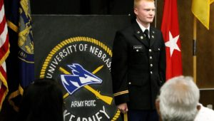 UNK graduate Cannon Marchand participates in an ROTC commissioning ceremony Friday in the Nebraskan Student Union Antelope Room. Marchand, who received the rank of second lieutenant in the Nebraska Army National Guard, will serve with the 195th Forward Support Company in Omaha. (Photo by Tyler Ellyson, UNK Communications)