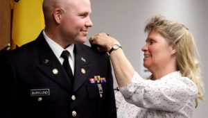 James Burklund has his new rank pinned by his mother, Cheri Mehuron, during an ROTC commissioning ceremony Friday at UNK. Burklund, who is currently pursuing a master's degree through UNK, is a second lieutenant with the Nebraska Army National Guard's 1075th Transportation Company in McCook. (Photo by Tyler Ellyson, UNK Communications)