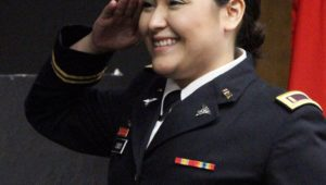 Jeysel Olmos gives her first salute as a second lieutenant in the Nebraska Army National Guard during an ROTC commissioning ceremony Friday at UNK. (Photo by Tyler Ellyson, UNK Communications)