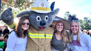From left, UNK students Marlana Kent, Marissa Asche and Leslie Braun are pictured with a koala mascot during a NAIDOC Week event in Australia, where they spent three weeks studying abroad. NAIDOC Week celebrates the history, culture and achievements of Australia's indigenous people. (Courtesy photo)