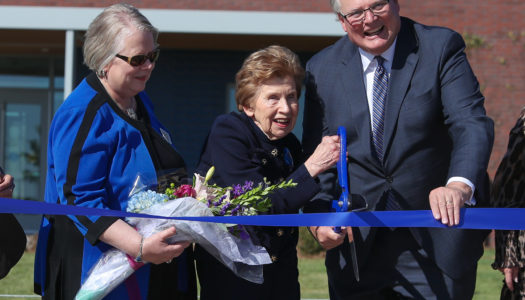 University of Nebraska at Kearney Chancellor Doug Kristensen, right, and University of Nebraska Interim President Susan Fritz, left, cut the ribbon at Tuesday's event celebrating the completion of the new Plambeck Early Childhood Education Center. The center will open Nov. 4. (Photo by Corbey R. Dorsey, UNK Communications)