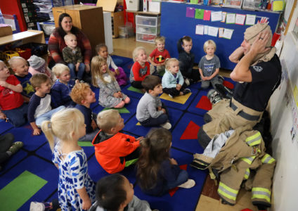 'Hi, fireman': Community helpers visit UNK Child Development Center