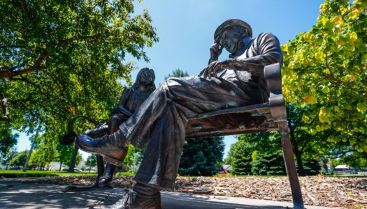 """Afternoon in the Park, a bronze sculpture by Mark Lundeen at Harmon Park, is among artwork featured in a new booklet, """"Kearney Art: Going Public."""" The publication was produced by the University of Nebraska at Kearney. (Photo by Corbey R. Dorsey, UNK Communications)"""